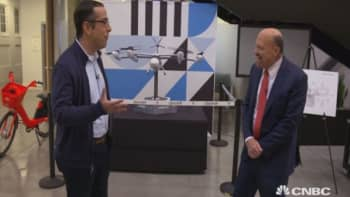 Head of Uber Freight Lior Ron (left) and CNBC's Jim Cramer (right) tour an Uber facility.