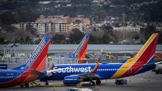 Southwest Airlines Co. aircraft are on the runway on Friday, January 19, 2018, at the San Francisco International Airport (SFO) in San Francisco, California, USA. Southwest Airlines Co. is expected to announce gains on January 25th. Photographer: David Paul Morris / Bloomberg on Getty Images