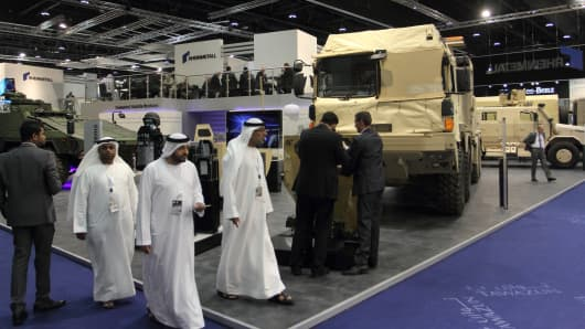 Attendees walk the floor at IDEX, the International Defence Exhibition and Conference, in Abu Dhabi in 2015.