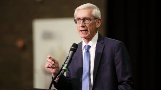 Tony Evers, then-Democratic nominee for governor of Wisconsin, speaks during a campaign rally for Democratic candidates in Milwaukee, Wisconsin, on Monday, Oct. 22, 2018.