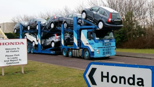 A transporter loaded with Honda cars leaves the Honda car factory in Swindon, southwest England, on January 30, 2009. Workers at Honda's British factory made the last cars Friday before a four-month shutdown caused by a sharp fall in worldwide sales. Production at the Japanese giant's plant in Swindon, southwest England, will be halted until June 1, with 4,200 workers receiving full pay for the first two months, reduced to 60 percent for the rest of the shutdown. AFP PHOTO/Max Nash (Photo credit should read MAX NASH/AFP/Getty Images)