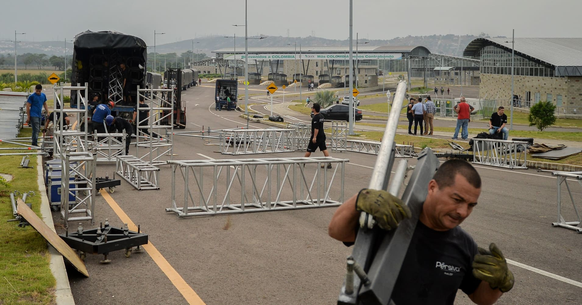 On February 18 2019, Workers assemble the platform for the February 22 concert organized by British billionaire Richard Branson to raise money for the Venezuelan relief effort in Cucuta, Colombia, on the Tienditas International Bridge.