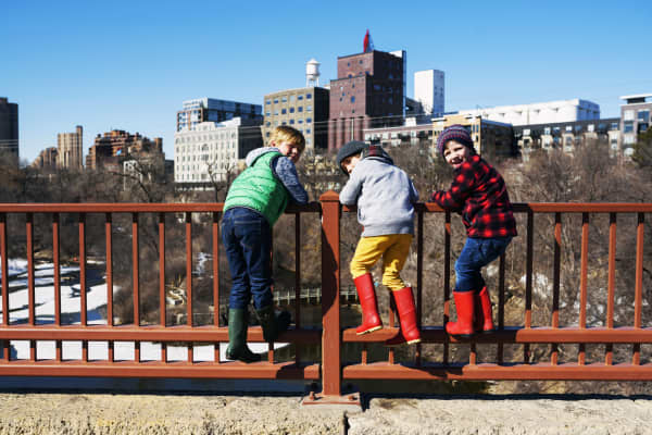 Children standing on Stone Arch bridge in Minneapolis, Minnesota.