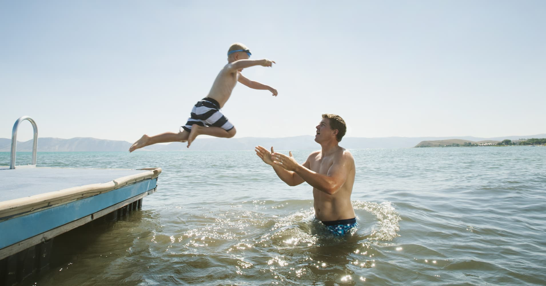 A child jumps into a lake hoping to be caught by his father in Garden City, Utah.