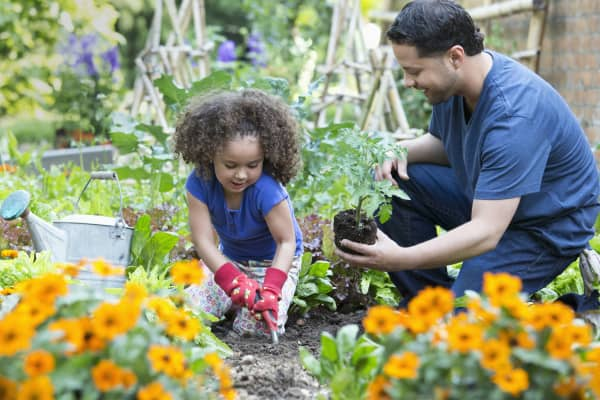 A father and daughter garden together in Richmond, Virginia.