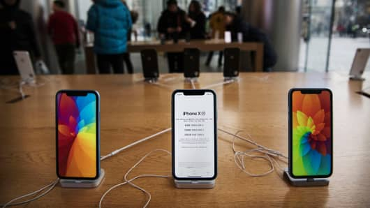 Apple iPhones are seen on display at an Apple Store on January 7, 2019 in Beijing, China.