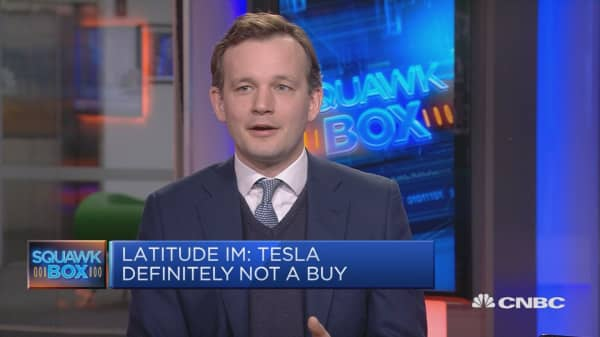 Tesla will likely get bought by a tech company, analyst says