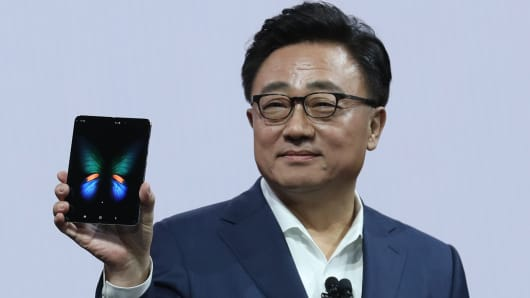 Samsung's Mobile Division President and CEO DJ Koh holds the new Samsung Galaxy Fold smartphone during the Samsung Unpacked event on February 20, 2019 in San Francisco, California.