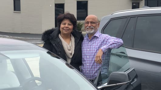 Indu and Shawn Chhabra, co-founders of Laptop Universe, drive a Tesla Model 3.