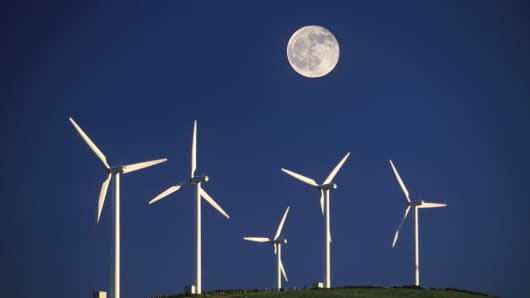 Windfarm at night with full moon. Wales, UK