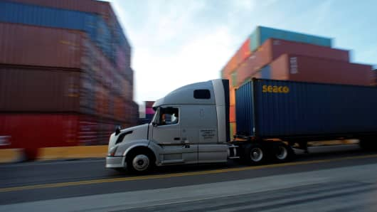 A truck hauls a shipping container at Yusen Terminals (YTI) on Terminal Island at the Port of Los Angeles in Los Angeles, California