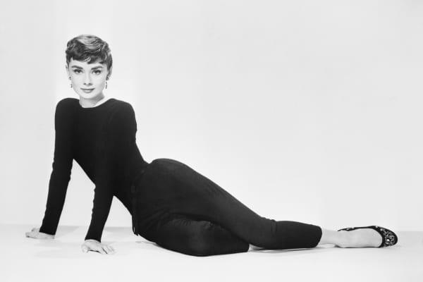 "Audrey Hepburn posing to promote the film ""Sabrina."""