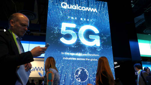 Attendees walk by the Qualcomm booth during CES 2019 at the Las Vegas Convention Center on January 9, 2019 in Las Vegas, Nevada.