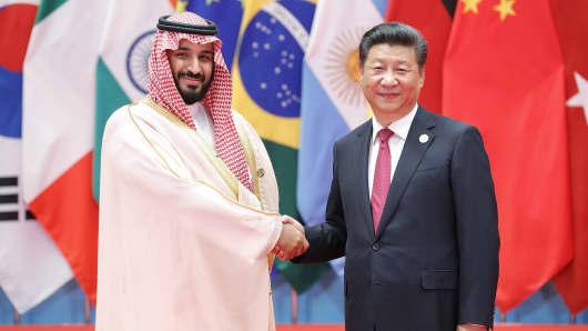 HANGZHOU, CHINA - SEPTEMBER 04: Chinese President Xi Jinping (right) shakes hands with Saudi Arabian Crown Prince Mohammed bin Salman bin Abdulaziz Al Saud to the G20 Summit on September 4, 2016 in Hangzhou, China.