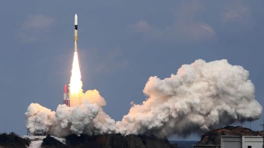 Japan's H-IIA rocket, carrying the space probe Hayabusa2, lifts off from the launch pad of the Japan Aerospace Exploration Agency (JAXA) Tanegashima Space Center at Takegashima island in Kagaoshima prefecture, on Japan's southern island of Kyushu on December 3, 2014.
