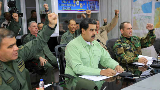 Venezuela's President Nicolas Maduro takes part in a video conference with members of the military in Caracas, Venezuela February 21, 2019.