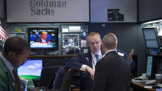 Traders work at Goldman Sachs booth on the floor of the New York Stock Exchange in New York.