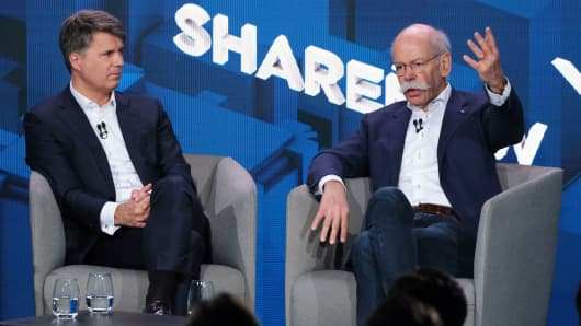 Harald Krüger (L), CEO of BMW AG, and Dieter Zetsche, CEO of Daimler AG, speak to the media about a new joint effort between the two automakers in carsharing on February 22, 2019 in Berlin, Germany.