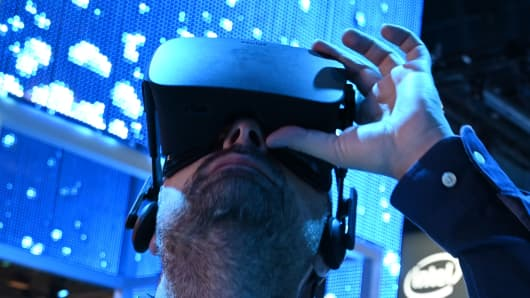 An attendee wears a Genius VR headset at the Intel booth during CES 2019 consumer electronics show, January 10, 2019 at the Las Vegas Convention Center in Las Vegas, Nevada.