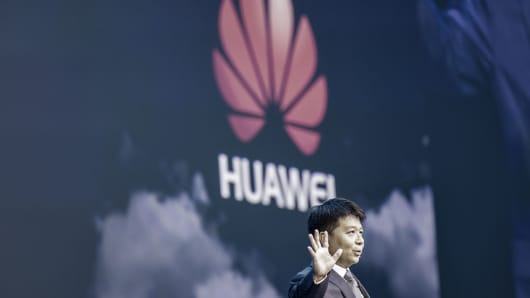Guo Ping, rotating chief executive officer and deputy chairman of Huawei Technologies Co., gestures while speaking during a keynote address at the Huawei Connect 2017 conference in Shanghai, China, on Tuesday, Sept. 5, 2017. Huawei aims to establish a union of cloud-service providers similar to global aviation alliances such as Sky Team, Guo said. Photographer: Qilai Shen/Bloomberg via Getty Images