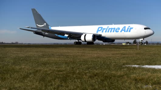 A wide body aircraft emblazoned with Amazon's Prime logo lands at Lehigh Valley International Airport in Allentown, Pennsylvania, U.S. December 20, 2016. Picture taken December 20, 2016. To match Insight AMAZON.COM-SHIPPING/ REUTERS/Mark Makela