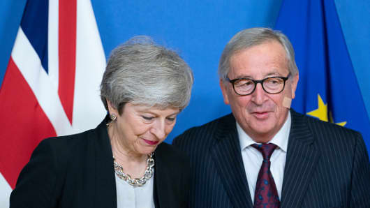 Theresa May, U.K. prime minister, left, and Jean-Claude Juncker, president of the European Commission, stand for a photo opportunity ahead of talks in Brussels, Belgium, on Wednesday, Feb. 20, 2019.