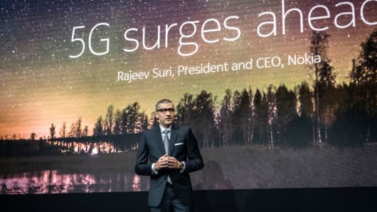 Rajeev Suri, president and CEO of Nokia, is seen speaking during a presentation of new products.