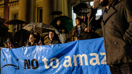 Demonstrators shout slogans and hold a banner during a protest against the planned Amazon.com Inc. office hub in the Long Island City neighborhood in the Queens borough of New York, U.S., on Monday, Nov. 26, 2018.