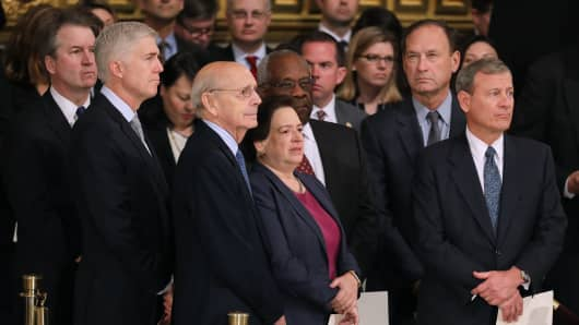 (L-R) U.S. Supreme Court associate justices Brett Kavanaugh, Neil Gorsuch, Stephen Breyer, attend a memorial ceremony for former U.S. President George H.W. Bush in the U.S. Capitol Rotunda December 03, 2018 in Washington, DC.