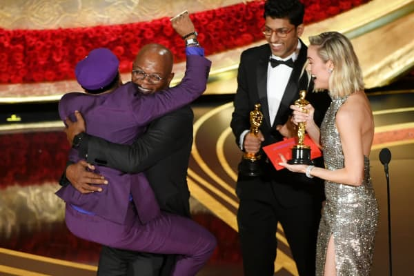 Spike Lee accepts the Best Adapted Screenplay award for 'BlacKkKlansman' from Samuel L. Jackson onstage during the 91st Annual Academy Awards at Dolby Theatre on February 24, 2019 in Hollywood, California.