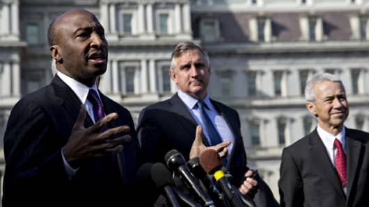 Ken Frazier, chairman and chief executive officer of Merck & Co., left, speaks as Robert Bradway, president and chief executive officer of Amgen Inc., center, and Joaquin Duato, executive vice president and worldwide chairman of pharmaceuticals at Johnson & Johnson, listen during a news conference outside the White House following a meeting with U.S. President Donald Trump, not pictured, in Washington, D.C., U.S., on Tuesday, Jan. 31, 2017.