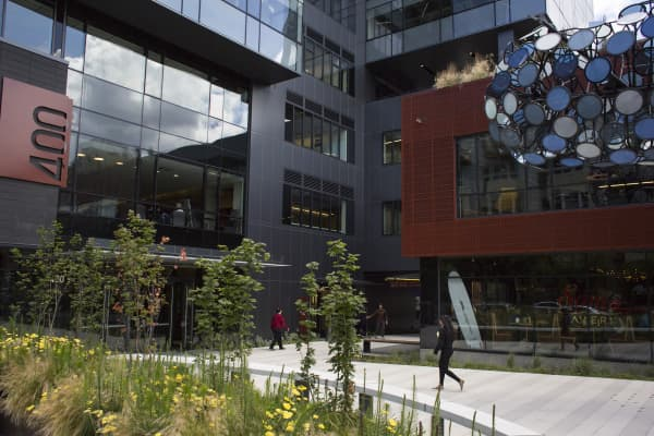 Pedestrians walk past the Amazon headquarters in the South Lake Union neighborhood of Seattle.