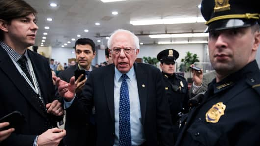 Sen. Bernie Sanders, I-Vt., talks with reporters in the Capitol on Thursday, February 14, 2019.
