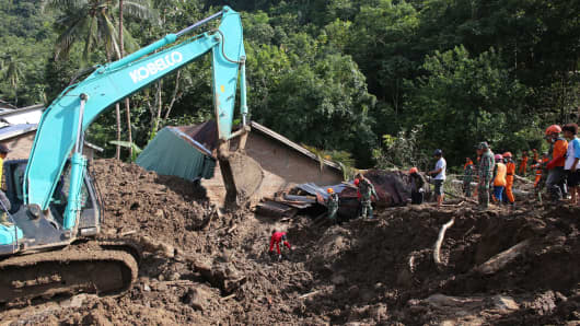 In a previous landslide, Indonesian search and rescue personnel search for victims in Manuju subdistrict, Gowa regency, South Sulawesi on Jan. 30, 2019, following flooding and landslides on the island. Floods and landslides are common in Indonesia during the monsoon season.