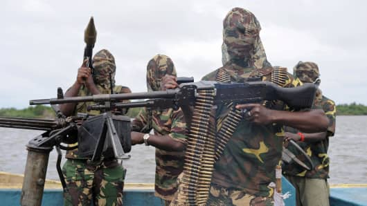 Fighters with the Movement for the Emancipation of Niger Delta (MEND) prepare for an operation against the Nigerian army in Niger Delta on September 17, 2008.