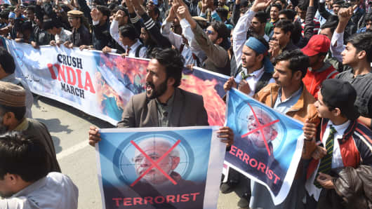 Students associated with religious political party Pakistan Jamaat-e-Islami chant slogans during an anti-India protest rally, in Lahore on Feb. 27, 2019.
