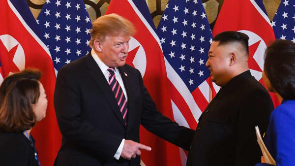 US President Donald Trump (2nd L) and North Korea's leader Kim Jong Un arrive for a meeting at the Sofitel Legend Metropole hotel in Hanoi on February 27, 2019.