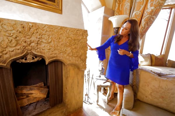 Edlich explains the fireplace mantle is made from an ornate stone door surround from India.