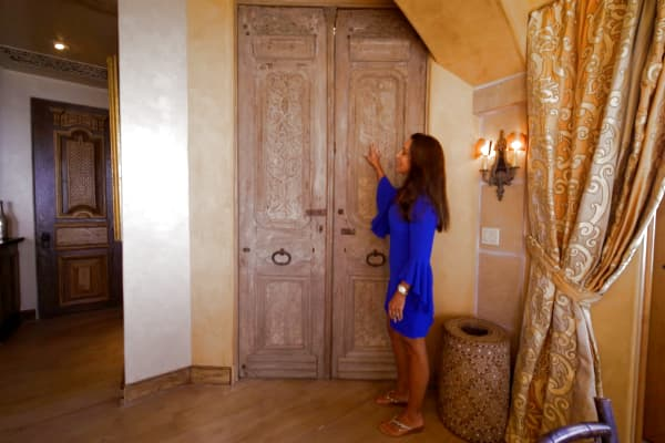 Edlich explains the provenance of the antique doors that lead to her kitchen.