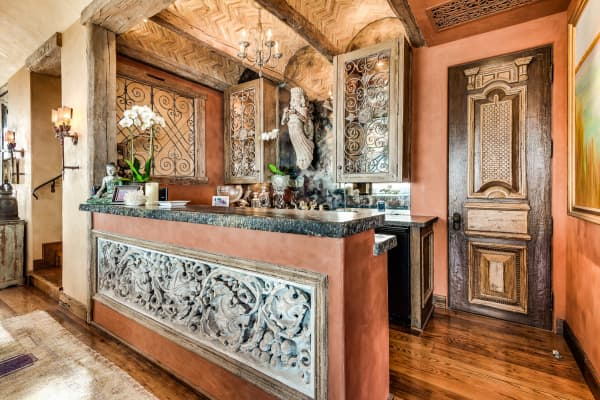 Edlich created a bar off the living room with rare antiques she integrated into its design.