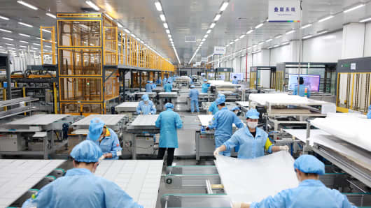 Employees work on the production line of solar panel at Risen Energy Co., Ltd on February 21, 2019 in Ningbo, Zhejiang Province of China.