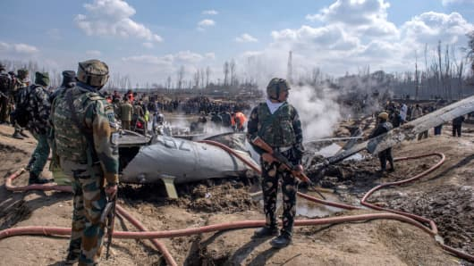 Indian government and military forces attend to the scene of a crashed Indian Air Force aircraft on February 27, 2019 in Budgam west of Srinagar, the summer capital of Indian administered Kashmir, India.