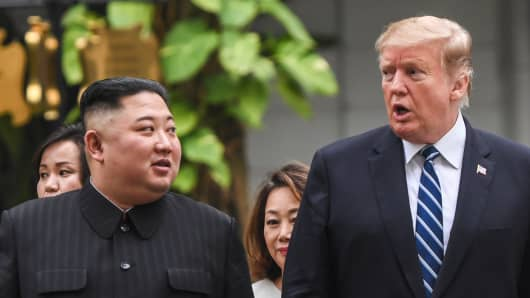 U.S. President Donald Trump walks with North Korean leader Kim Jong Un during a break in talks at the U.S.-North Korea summit in Hanoi on February 28, 2019.
