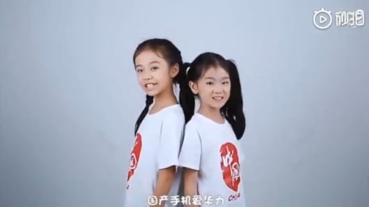 A screenshot of a music video promoting Chinese tech giant Huawei.