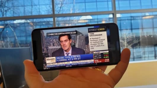 Watching CNBC on an iPhone XS Max