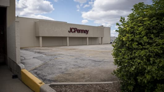 Signage is displayed outside a JC Penney Co. store in Chicago, Illinois.