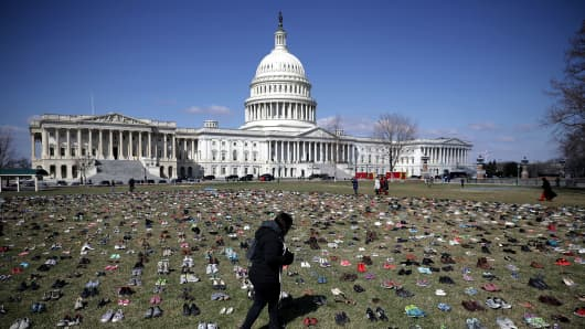 Seven thousand pairs of shoes, representing the children killed by gun violence since the mass shooting at Sandy Hook Elementary School in 2012, are spread out on the lawn on the east side of the U.S. Capitol March 13, 2018 in Washington, DC.