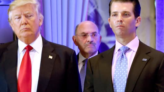 US President-elect Donald Trump along with his son Donald, Jr., arrive for a press conference at Trump Tower in New York, as Allen Weisselberg (C), chief financial officer of The Trump, looks on.