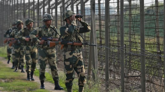 India's Border Security Force (BSF) soldiers patrol along the fenced border with Pakistan in Ranbir Singh Pura sector near Jammu February 26, 2019.