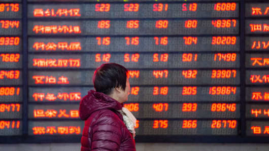 An investor watches the electronic board at a stock exchange hall on Feb. 11, 2019 in China.